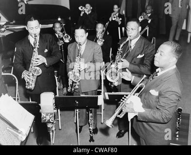 Louis Armstrong (1901-1971), African American Jazz musician, conducting his band during a radio broadcast in 1937. Stock Photo