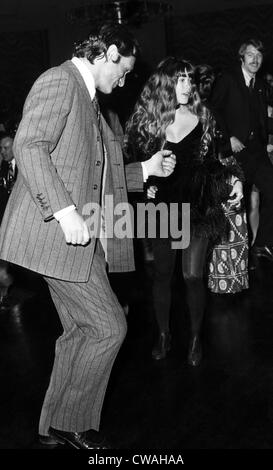 Hugh Hefner and Barbi Benton dance at a party at the Playboy Club-Hotel in McAfee, New Jersey. ca 1972. Courtesy - Stock Photo