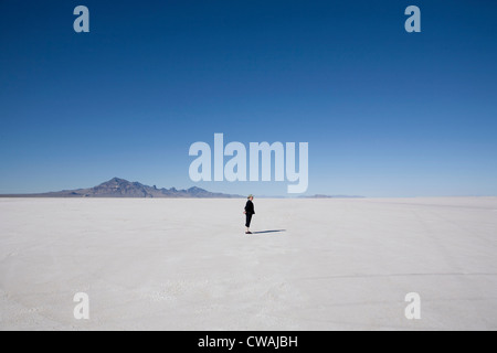 Woman standing on the Bonneville Salt Flats, Tooele County, Utah, USA - Stock Photo