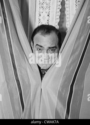 Enrico Caruso (1873-1921), smiling in playful portrait for Bain News Service photographer. Ca. 1915. - Stock Photo