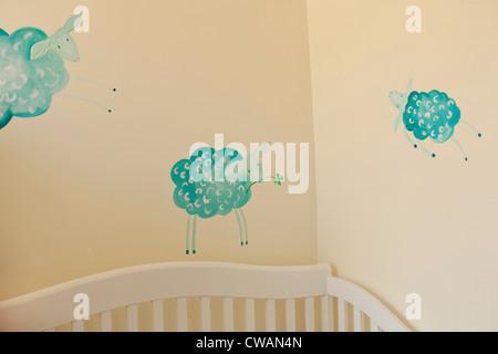 Sheep painted on nursery wall - Stock Photo