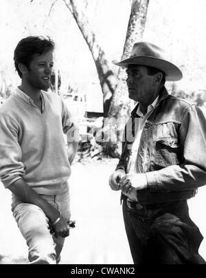 Peter Fonda with father, Henry Fonda, on location in Sedona, Arizona of the film 'THE ROUNDERS'. February 6, 1965.. - Stock Photo
