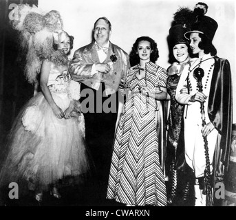 Costume party at San Simeon. Irene Dunne, William Randolph Hearst, Bette Davis, Louella Parsons & Mary Brian, 1937. - Stock Photo