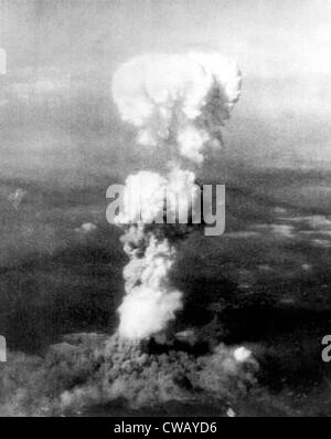 Atomic bomb. A mushroom cloud rises more than 20,000 feet into the air over Hiroshima, Japan after an atomic bomb - Stock Photo
