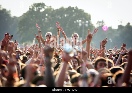 The crowd enjoying the live music at V Festival in Hylands Park, Chelmsford, Essex - Stock Photo