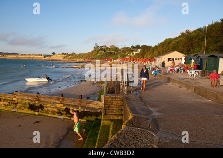 Bathers, Beach Huts, Cafe, Beach, Boats, Colwell Bay, Isle of Wight, England, UK, - Stock Photo