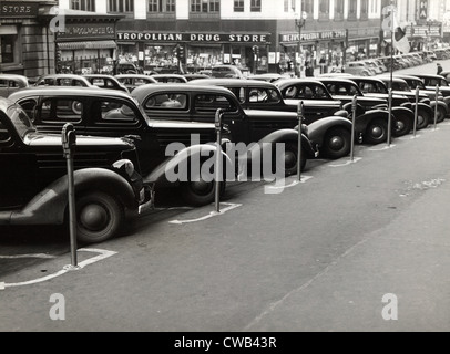 Cars parked diagonally along parking meters, Omaha, Nebraska, photograph by John Vachon, November, 1938. - Stock Photo