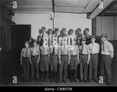 Group of messenger boys, original caption: 'A typical group of messengers at Postal Telegraph Company's main office, - Stock Photo