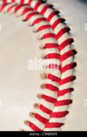 Baseball Closeup view of a seam stitching the hide together with twine. - Stock Photo