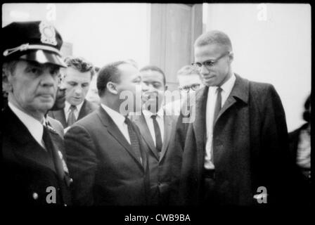 Martin Luther King Jr., and Malcolm X, waiting for press conference, 1964. - Stock Photo
