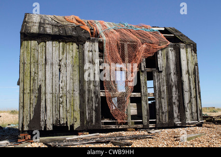 An Old derelict fishermans hut on the  beach at Dungeness in Kent. - Stock Photo