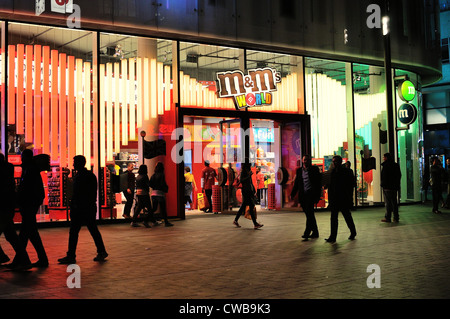 Facade of The M&M store Central London at night - Stock Photo