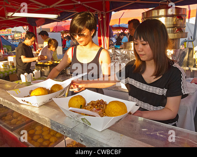Hong Kong style curry fish balls served with stir fried noodles at Richmond Night Market, Richmond, British Columbia, - Stock Photo