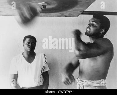 Muhammad Ali, works out on light bag in Miami, Florida. 1965. - Stock Photo