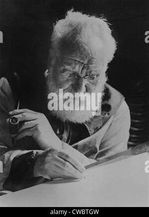 Alexander Graham Bell (1847-1922), writing at his desk in his study in Washington. 1913. - Stock Photo