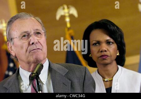 Secretary of Defense Donald H. Rumsfeld speaks to reporters as Secretary of State Condoleezza Rice listens. Baghdad - Stock Photo