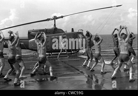 Marines doing jumping jacks on the deck of the amphibious assault ship USS NEW ORLEANS. Aug. 1 1982. (BSLOC_2011 - Stock Photo