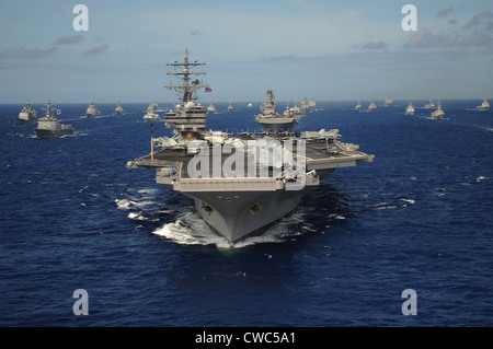 Aircraft carrier USS Ronald Reagan leads a formation of allied ships from through the Pacific Ocean. July 24 2010. - Stock Photo