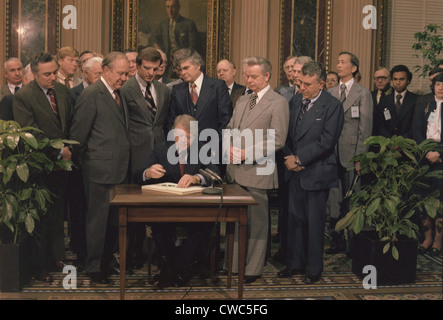 Jimmy Carter signs a Social Security Act on December 20 1977. The law rewarded workers over the age of 65 adjusted - Stock Photo