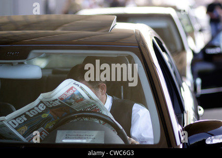 Berlin, driver reads tabloid - Stock Photo