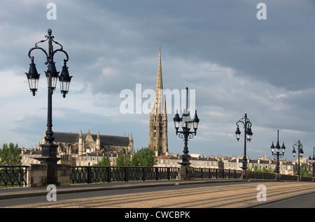 The old bridge Pont de Pierre, tower of Saint Michel church, Bordeaux city, Aquitaine, Gironde, France - Stock Photo