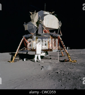 Apollo 11 Lunar Module on the Moon's surface. Astronaut Edwin Aldrin unpacks scientific experiments. July 20, 1969. - Stock Photo