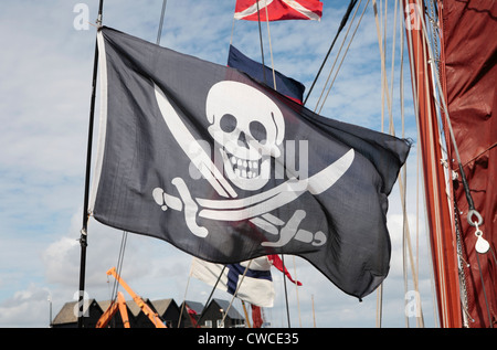 A skull and crossbones childrens flag at Whitstable harbour day - Stock Photo