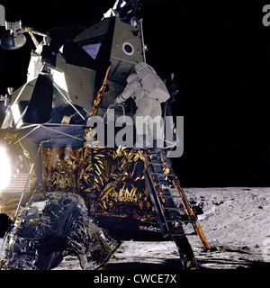 Apollo 12 Astronaut Alan Bean starts down the ladder of the Lunar Module 'Intrepid' to join Commander Charles Conrad - Stock Photo