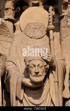 Paris, France. Notre Dame Cathedral. Detail of carved figure of St Denis in the portal of the left door or Porte - Stock Photo