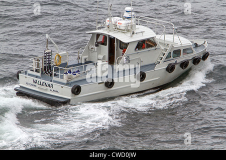 A Pilot boat transferring the harbourmaster on to the MS Oosterdam in ketchikan Alaska in May 2012 - Stock Photo