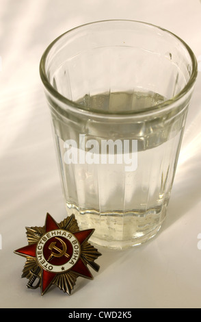 Order 'Great Patriotic War' and glass. The custom of 'wash' Order and pip. - Stock Photo