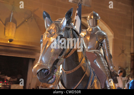 Armour for horse and rider on display in historic Warwick Castle - Stock Photo
