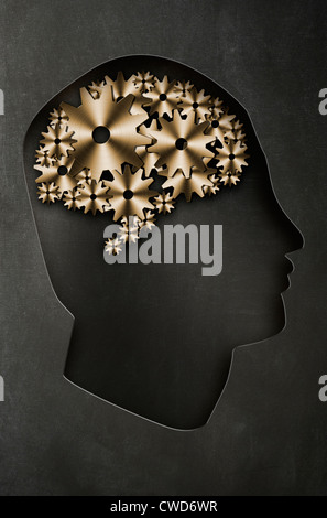 Profile of a man's head with a representation of the brain as cogs and gears. Concept image - Stock Photo
