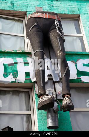 Camden Market high Street - giant legs on shop front display - London UK - Stock Photo