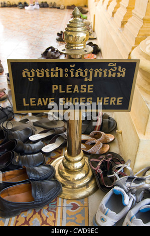 Vertical close up of lots of pairs of shoes removed to enter into the Royal Palace in Phnom Penh. - Stock Photo
