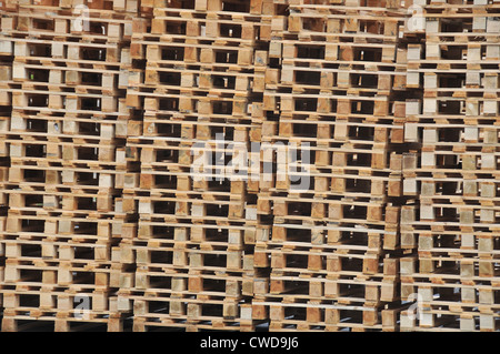 a stack of wooden pallets ready to be used to transport goods Puy de Dome Auvergne Massif Central France - Stock Photo