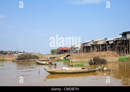 Horizontal wide angle view of the stilted houses of Kompong Khleang, the floating village on Tonle Sap Lake in Cambodia - Stock Photo
