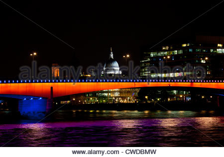 London Bridge with St Paul's Cathedral in the background during the Olympics 2012. - Stock Photo