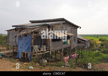 Horizontal wide angle view of a stilted house in Kompong Khleang, the floating village on Tonle Sap Lake in Cambodia - Stock Photo