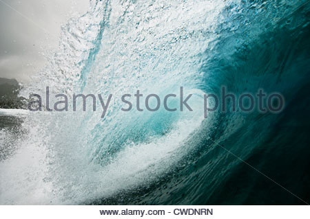 Breaking wave over a coral reef, Rarotonga, Cook Islands. - Stock Photo