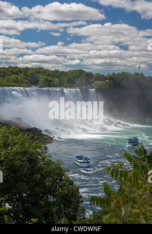 Niagara Falls, Ontario - Niagara Falls. Two boats in the Maid of the Mist fleet carry tourists to the edge of the - Stock Photo