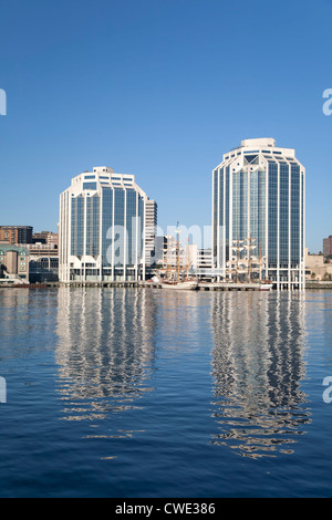 Tall ships docked in the early morning on Halifax's waterfront at Purdy's Wharf. - Stock Photo