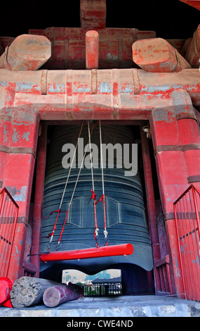 Ancient Red Bronze Bell Bell Tower Red Hammer, Beijing China - Stock Photo