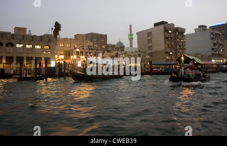 Dubai, the Old City on the Dubai Creek in the evening - Stock Photo