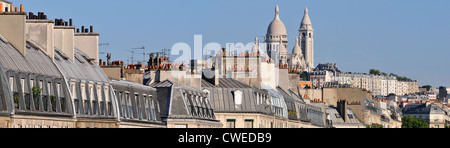 Paris, France. Sacre-Coeur and rooftops along Boulevard de Magenta. Panorama - Stock Photo