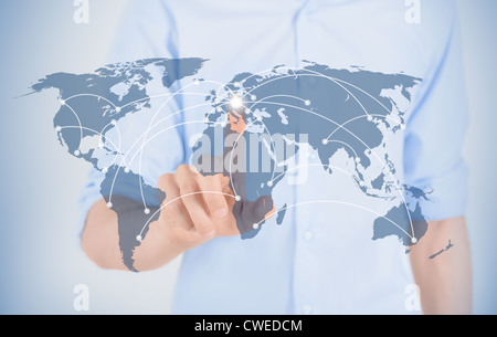 Man touching on world map with futuristic communication interface. - Stock Photo