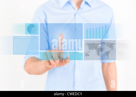 Man touching futuristic touchscreen interface with some graphic, charts and news. Isolated on white. - Stock Photo