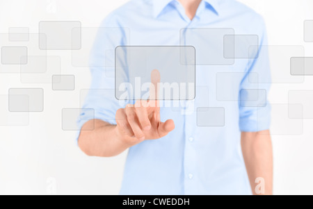 Man touching blank virtual screen. Isolated on white. - Stock Photo