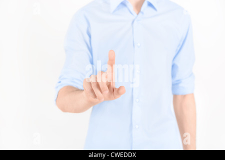 Man touching virtual screen. Isolated on white. - Stock Photo
