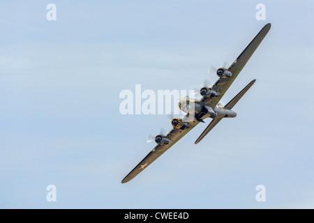 Memphis Belle Boeing B 17 bomber flying over Shoreham airfield - Stock Photo